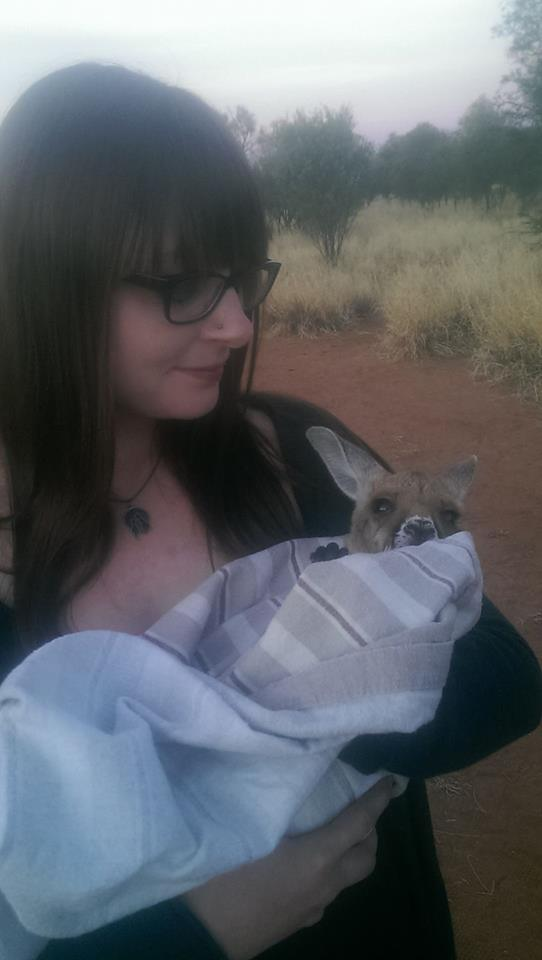 Kangaroo Sanctuary Alice Springs holding a joey