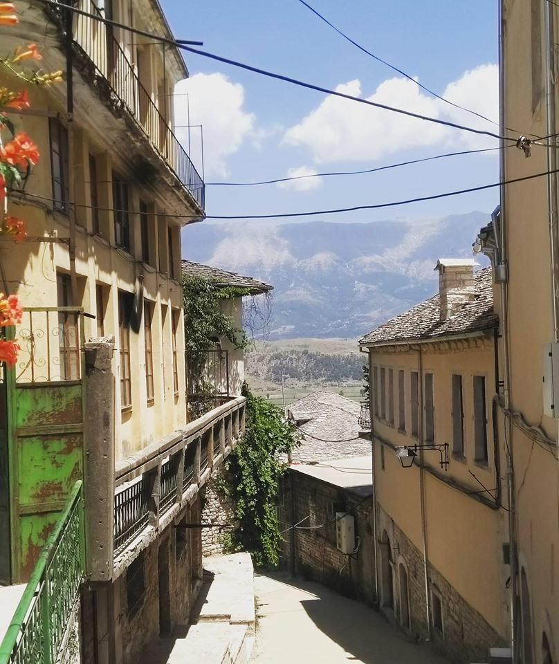 Steep streets with mountains behind in Gjirokaster in Albania