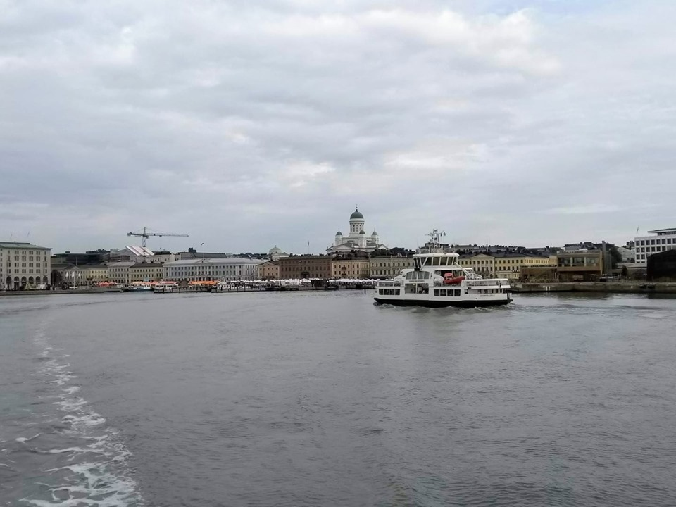 Helsinki Cathedral and city buildings and market stalls with the sea in front viewed from the ferry