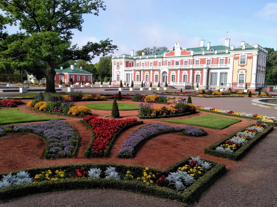 Kadriorg Palace with brightly-coloured flower patches in the gardens in front of it