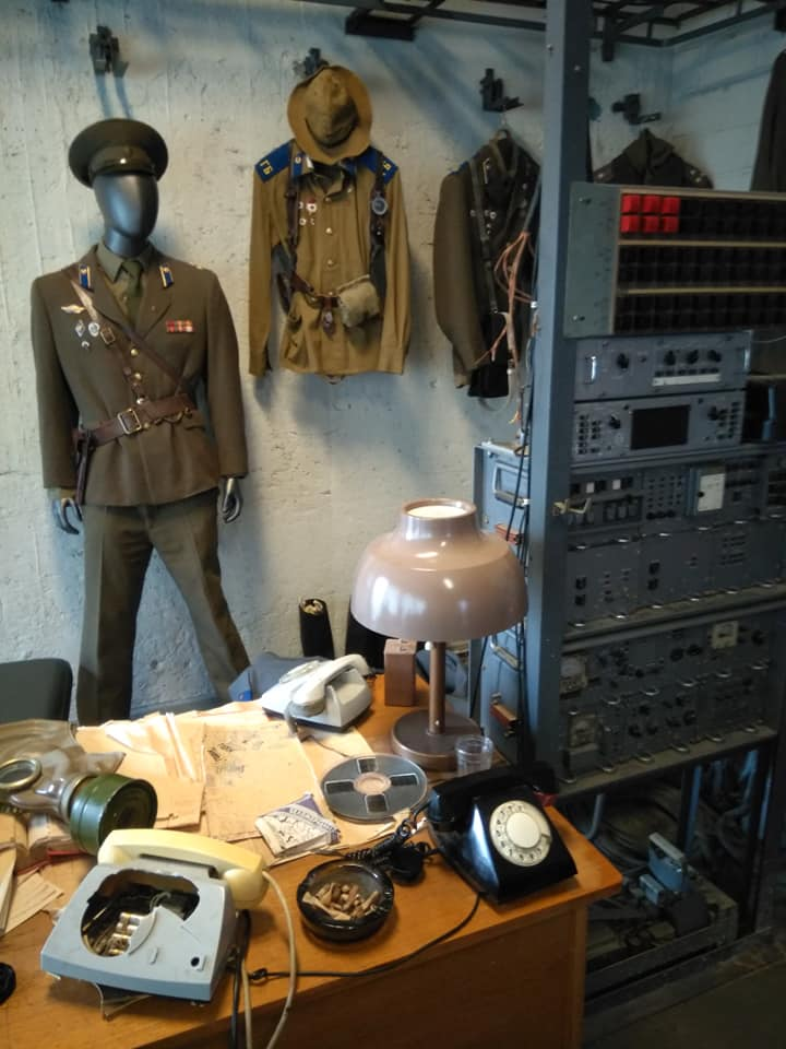 A KGB uniform, a smashed-up telephone and other paraphernalia from the days of this being a KGB office t