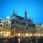 The buildings of the Grande Place in Brussels lit up at night