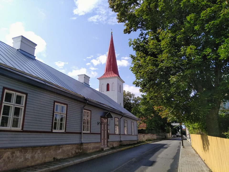 A white church with a red spire in Haapsalu's Old Town