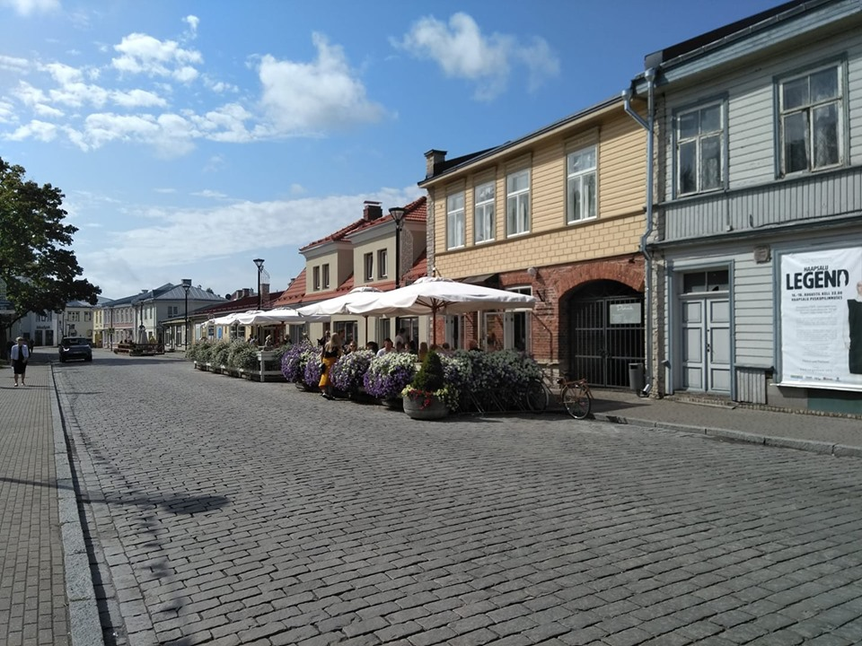 Wooden buildings and cafe tables in Haapsalu Old Town