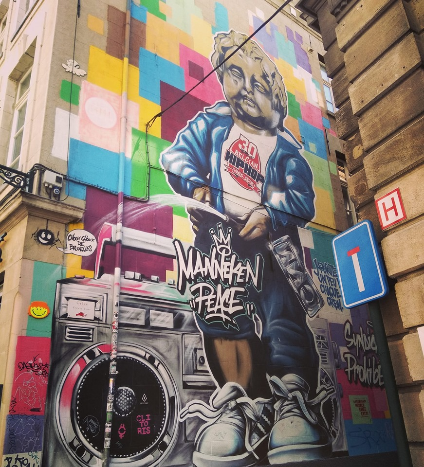 Street art depicting the Manneken Pis statue as a real boy