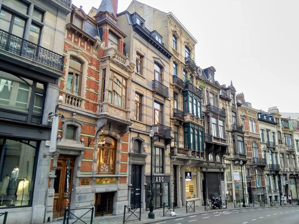 Buildings of different sizes, colours and styles on a street in Brussels
