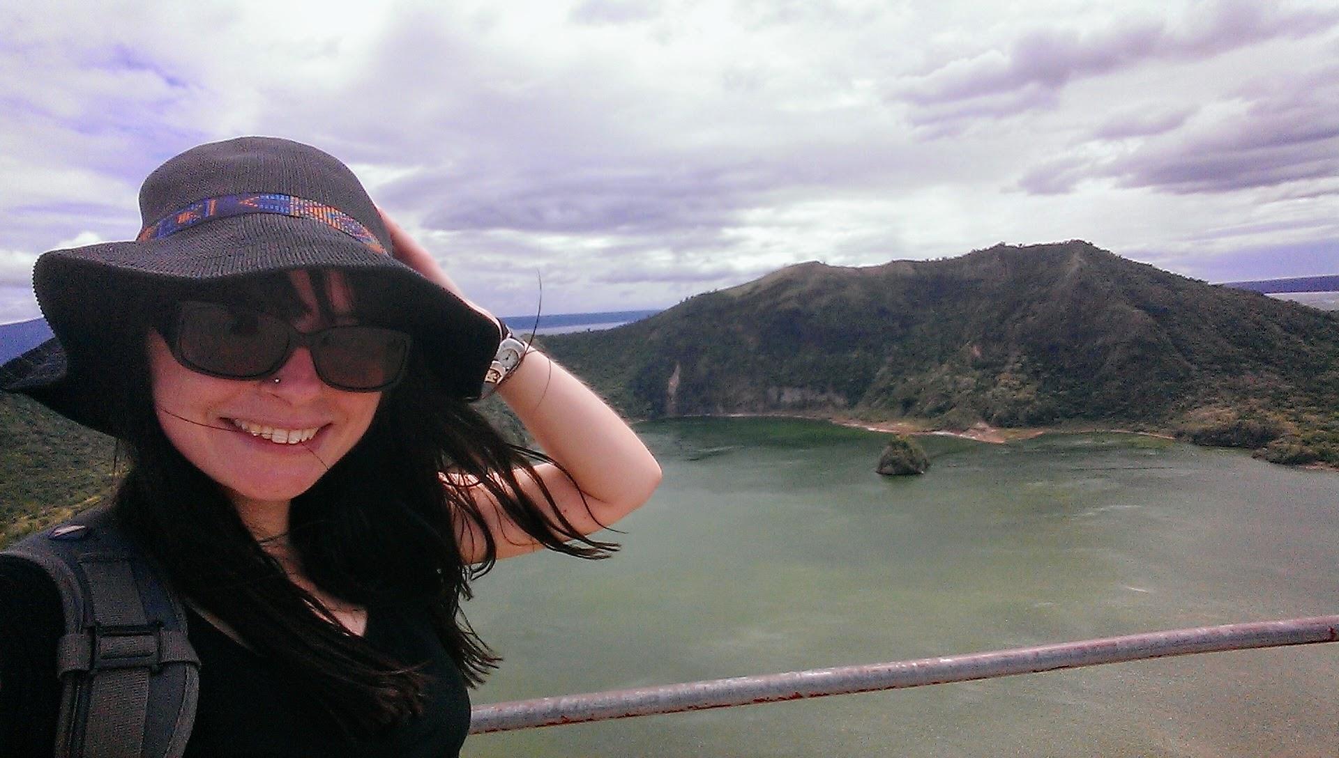 Rachel standing in front of Taal Volcano, Philippines