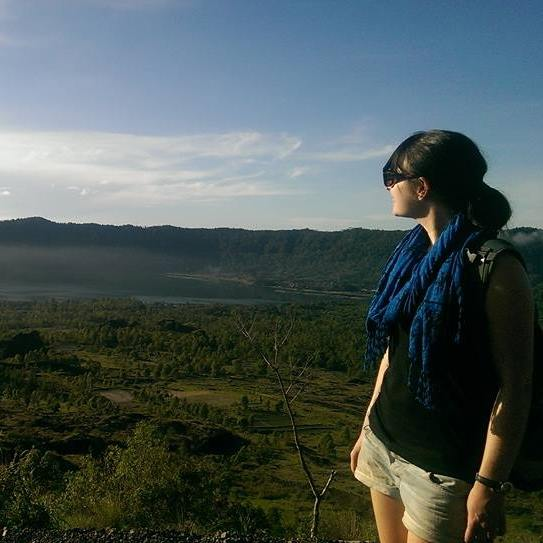Rachel on top of Mt Batur in Bali look at the view