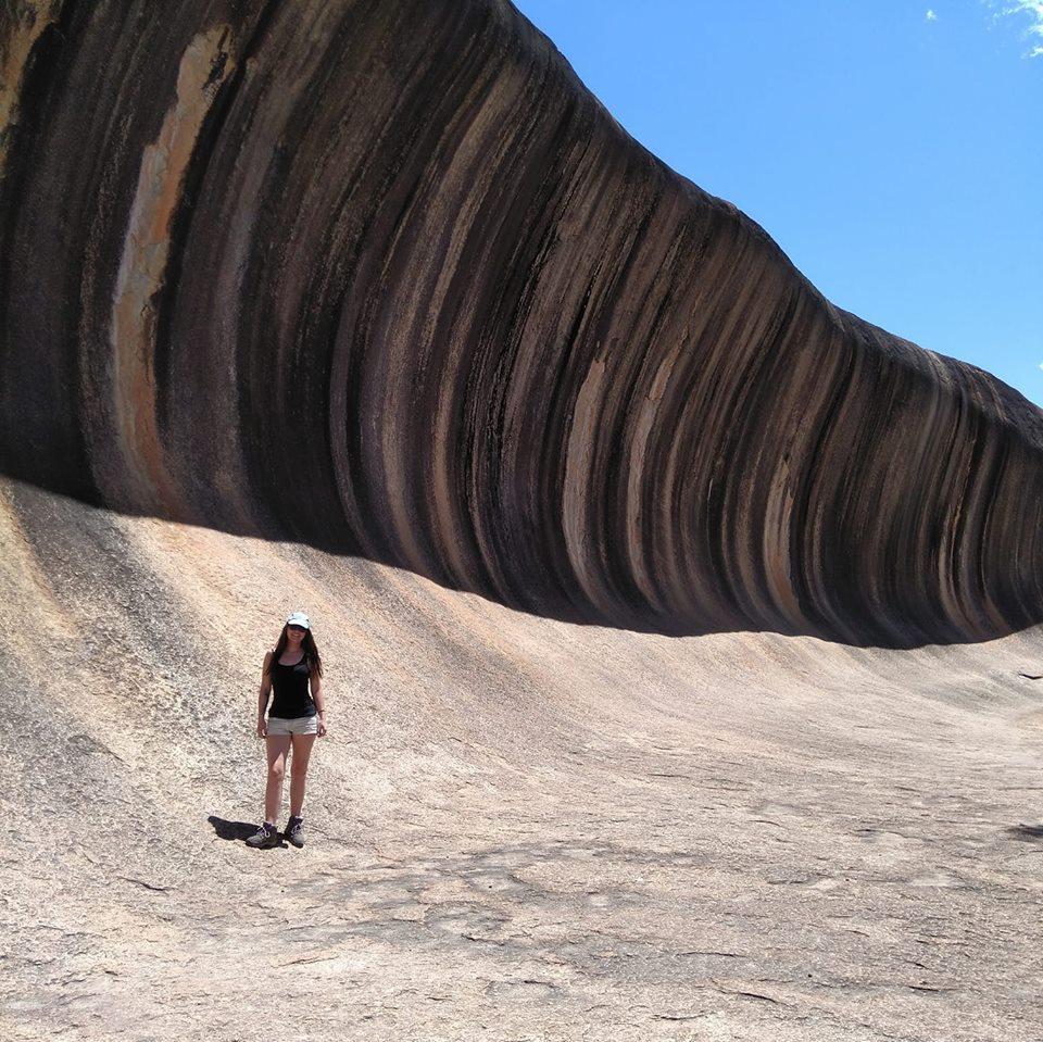 Rachel standing in front of Wave Rock, Western Australia