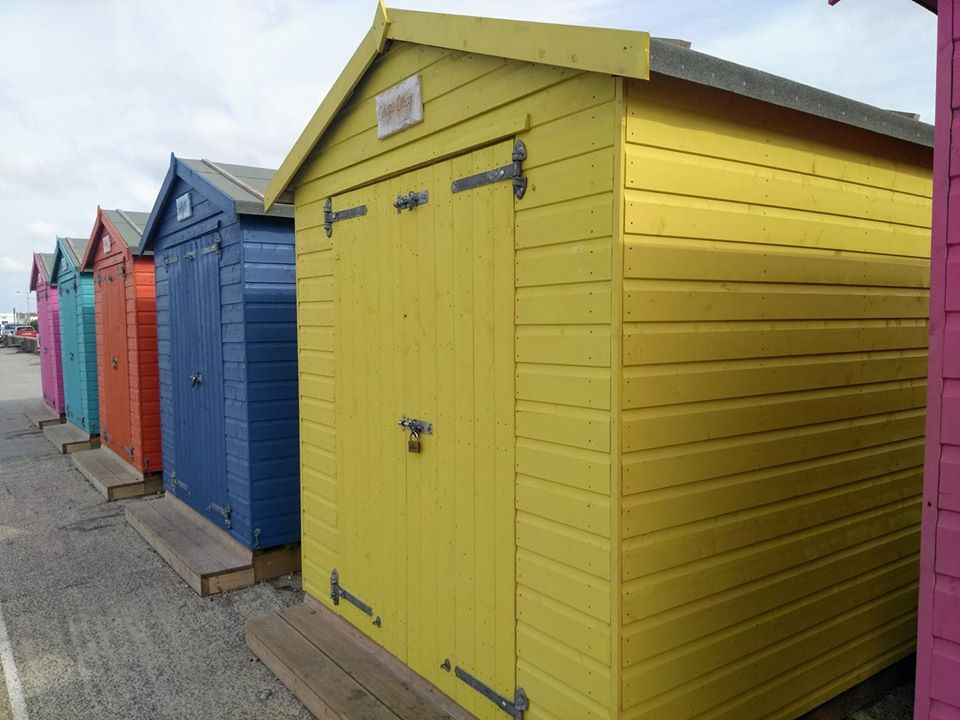 Brightly coloured beach huts at Seaford
