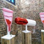 Artwork depicting menstrual products with glittery red blood at the Vagina Museum in Camden, London