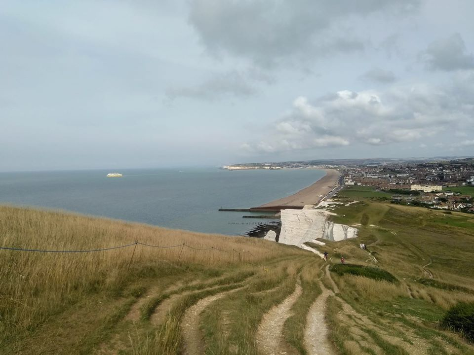 View back towards Seaford of cliff tops and sea