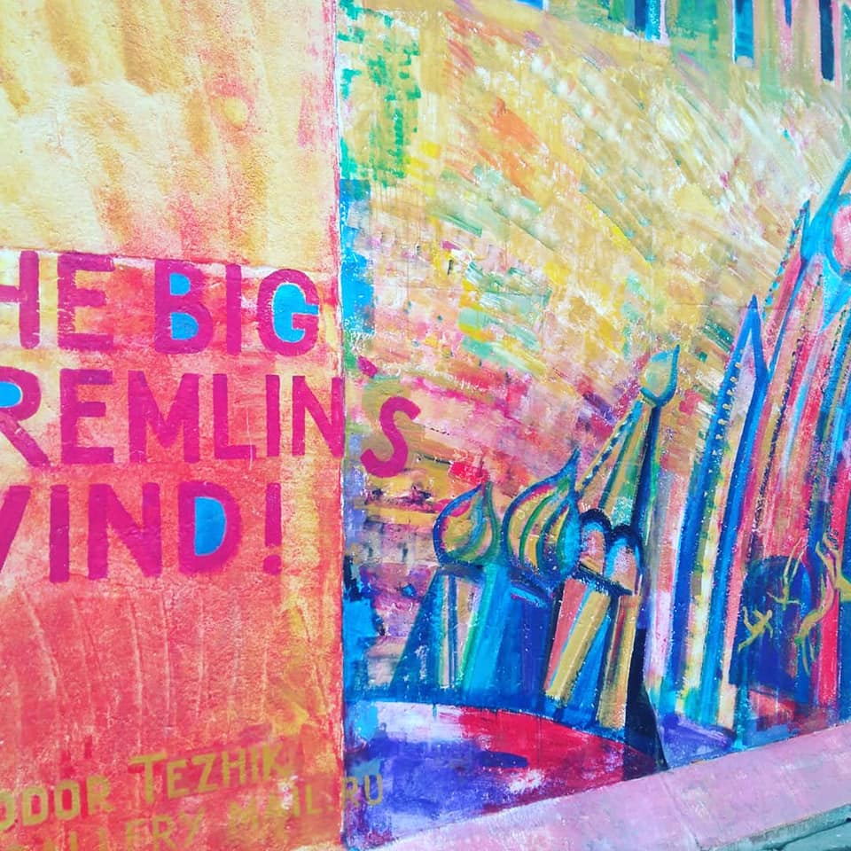 "A colourful mural at the East Side Gallery depicting the Kremlin being knocked sideways with the words ""The Big Kremlin's Wind"""