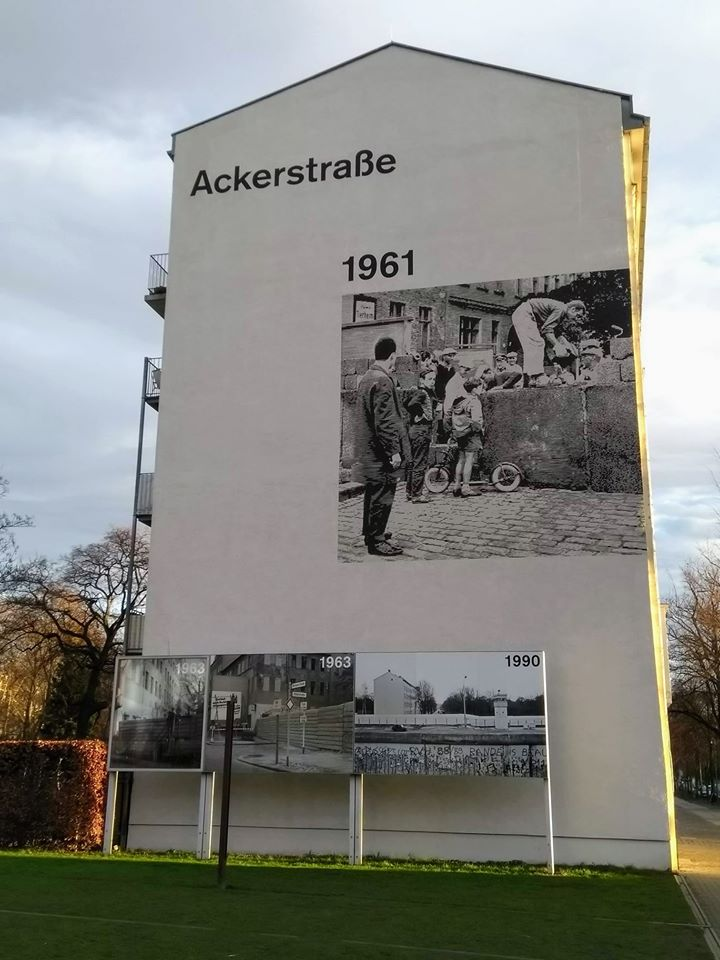 Photographs displayed on the wall of this building show how this junction looked at different stages of the Berlin Wall