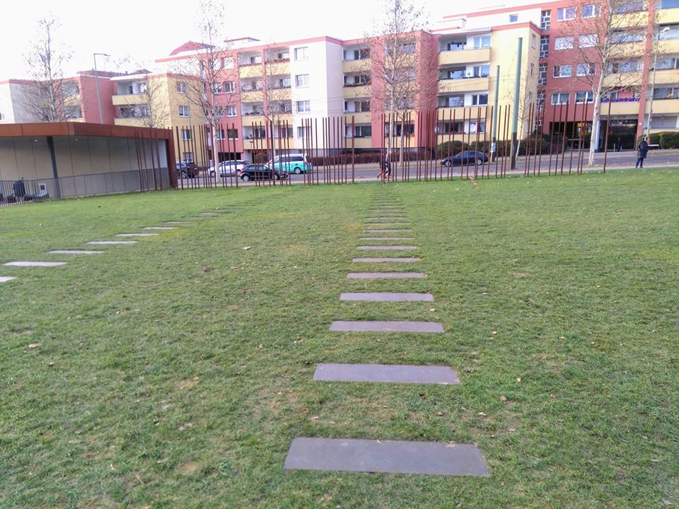 Paving stones mark out the route of an escape tunnel at the Berlin Wall
