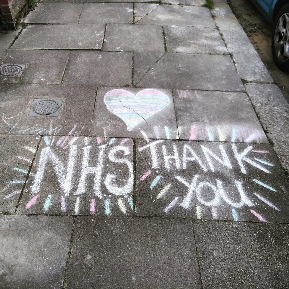 A chalked message on the pavement thanking the NHS